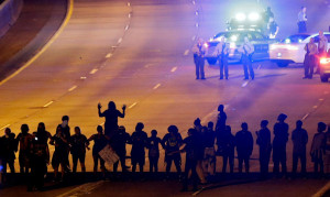Protesters block I-277 during a third night of unrest following Tuesday's police shooting of Keith Lamont Scott in Charlotte, N.C., Thursday, Sept. 22, 2016. Gerry Broome, The Associated Press